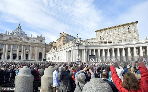Pope Francis delivers the sunday's Angelus prayer from the window of the apostolic palace overlooking St Peter's square after a mass for the 14th...