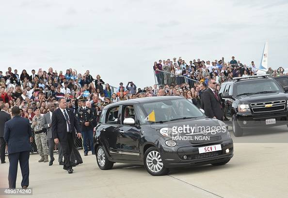 Pope Francis departs in a Fiat after arrival at Andrews Air Force Base in Maryland on September 22 2015 AFP PHOTO/MANDEL NGAN