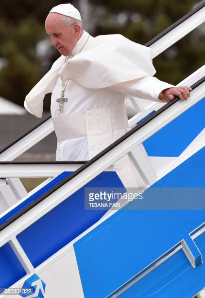 Pope Francis deplanes upon his arrival at the Monte Real Air Base central Portugal prior to visiting Fatima shrine on May 12 2017 Two of the three...