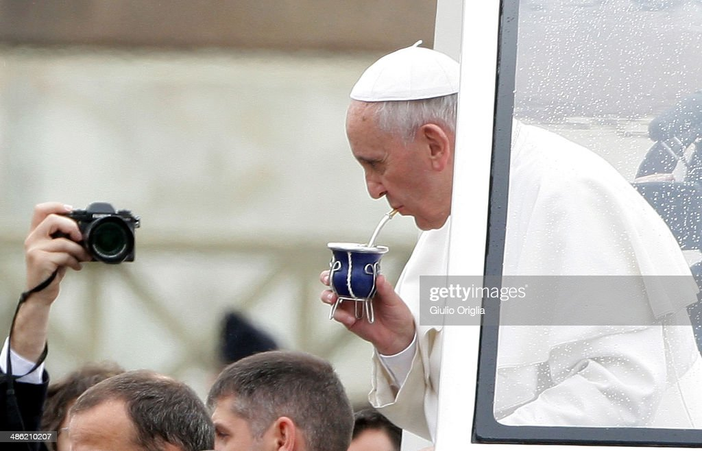 Pope Francis drinks mate as he holds his weekly audience on April 23, 2014 in Vatican City, Vatican. Pilgrims have started to arrive in St. Peter's Square for the Canonization ceremony for Pope John XXIII and John Paul II, which will take place on Sunday 27th.