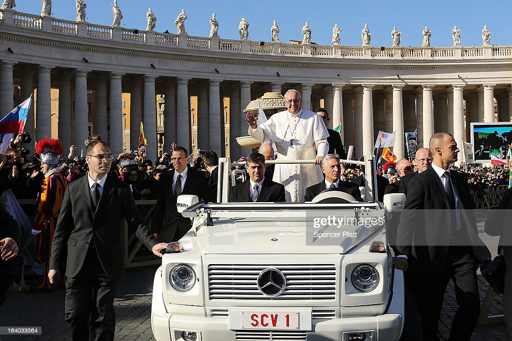 <a gi-track='captionPersonalityLinkClicked' href=/galleries/search?phrase=Pope+Francis&family=editorial&specificpeople=2499404 ng-click='$event.stopPropagation()'>Pope Francis</a> drives through the crowds during the Inauguration Mass for the Pope in St Peter's Square on March 19, 2013 in Vatican City, Vatican. The mass is being held in front of an expected crowd of up to one million pilgrims and faithful who have filled the square and the surrounding streets to see the former Cardinal of Buenos Aires officially take up his role as pontiff.