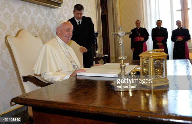 Pope Francis during a meeting with President Hery Rajaonarimampianina of Madagascar at his private library in the Apostolic Palace on June 28 2014 in...