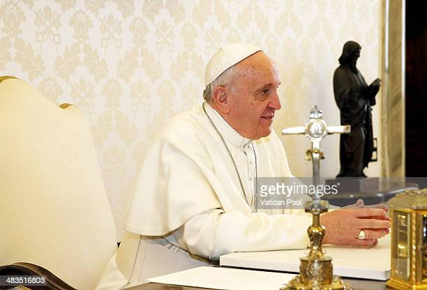 Pope Francis during a meeting with President of Greece Karolos Papoulias at his private library in the Apostolic Palace on March 28 2014 in Vatican...