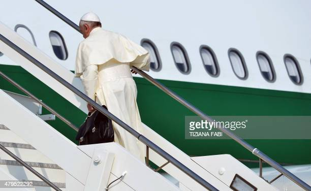 Pope Francis embarks on an airplane for his trip to Ecuador Bolivia and Paraguay on July 5 2015 at Rome's Fiumicino International Airport AFP PHOTO /...
