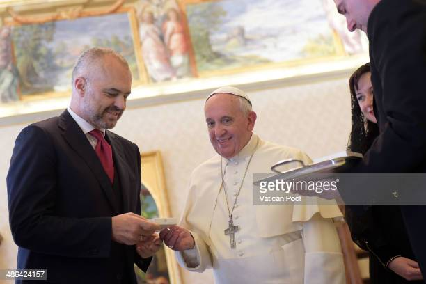 Pope Francis exchanges gifts with Albanian Prime Minister Edi Rama at his private library in the Apostolic Palace on April 24 2014 in Vatican City...