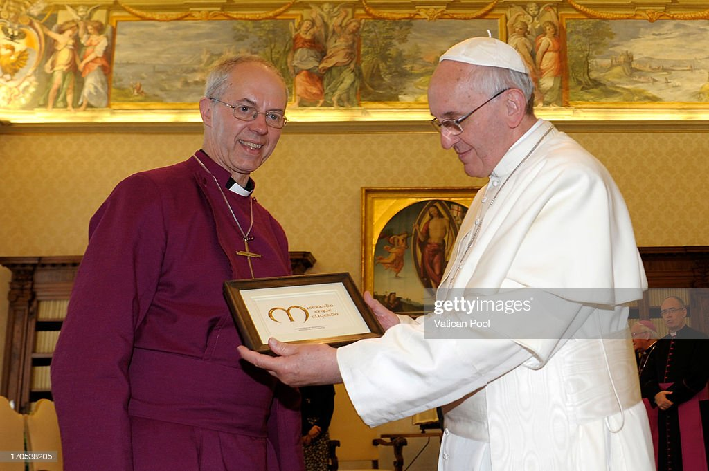 <a gi-track='captionPersonalityLinkClicked' href=/galleries/search?phrase=Pope+Francis&family=editorial&specificpeople=2499404 ng-click='$event.stopPropagation()'>Pope Francis</a> exchanges gifts with Archbishop of Canterbury <a gi-track='captionPersonalityLinkClicked' href=/galleries/search?phrase=Justin+Welby&family=editorial&specificpeople=9960447 ng-click='$event.stopPropagation()'>Justin Welby</a> at his private library on June 14, 2013 in Vatican City, Vatican. The Archbishop of Canterbury is in Rome for a meeting with <a gi-track='captionPersonalityLinkClicked' href=/galleries/search?phrase=Pope+Francis&family=editorial&specificpeople=2499404 ng-click='$event.stopPropagation()'>Pope Francis</a>, it is the first time the pair have met since they became leaders of their respective Churches in March.