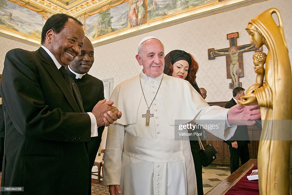 <a gi-track='captionPersonalityLinkClicked' href=/galleries/search?phrase=Pope+Francis&family=editorial&specificpeople=2499404 ng-click='$event.stopPropagation()'>Pope Francis</a> exchanges gifts with Cameroon President <a gi-track='captionPersonalityLinkClicked' href=/galleries/search?phrase=Paul+Biya&family=editorial&specificpeople=584630 ng-click='$event.stopPropagation()'>Paul Biya</a> and his wife <a gi-track='captionPersonalityLinkClicked' href=/galleries/search?phrase=Chantal+Biya&family=editorial&specificpeople=2564638 ng-click='$event.stopPropagation()'>Chantal Biya</a> during an audience at Vatican Apostolic Palace on October 18, 2013 in Vatican City, Vatican. During the colloquial discussions, satisfaction was expressed for good existing bilateral relations. Finally, attention was turned to various challenges relating to sub-Saharan Africa, emphasising Cameroon's commitment to security and peace in the Region.