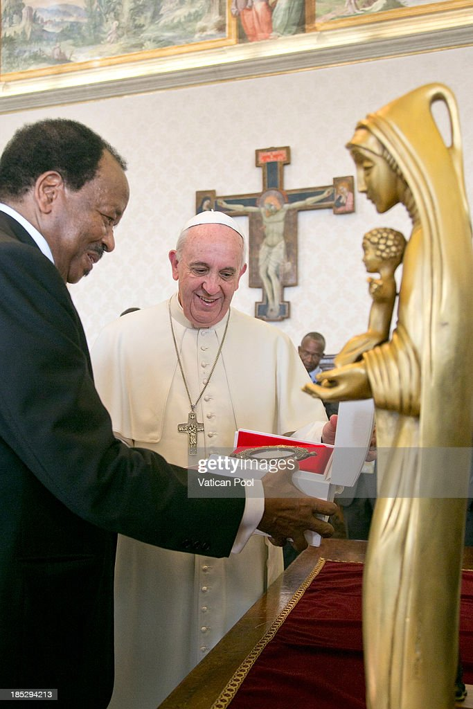 <a gi-track='captionPersonalityLinkClicked' href=/galleries/search?phrase=Pope+Francis&family=editorial&specificpeople=2499404 ng-click='$event.stopPropagation()'>Pope Francis</a> exchanges gifts with Cameroon President <a gi-track='captionPersonalityLinkClicked' href=/galleries/search?phrase=Paul+Biya&family=editorial&specificpeople=584630 ng-click='$event.stopPropagation()'>Paul Biya</a> during an audience at Vatican Apostolic Palace on October 18, 2013 in Vatican City, Vatican. During the colloquial discussions, satisfaction was expressed for good existing bilateral relations. Finally, attention was turned to various challenges relating to sub-Saharan Africa, emphasising Cameroon's commitment to security and peace in the Region.