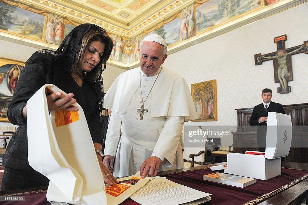 Pope Francis exchanges gifts with Costa Rica President <a gi-track='captionPersonalityLinkClicked' href=/galleries/search?phrase=Laura+Chinchilla&family=editorial&specificpeople=646370 ng-click='$event.stopPropagation()'>Laura Chinchilla</a> during a private meeting at his private library on November 8, 2013 in Vatican City, Vatican. During the cordial discussions, mention was made of the collaboration between Church and State in facing certain social issues, and the common attention of the Parties to various themes such as the defence of life and the protection of the environment.
