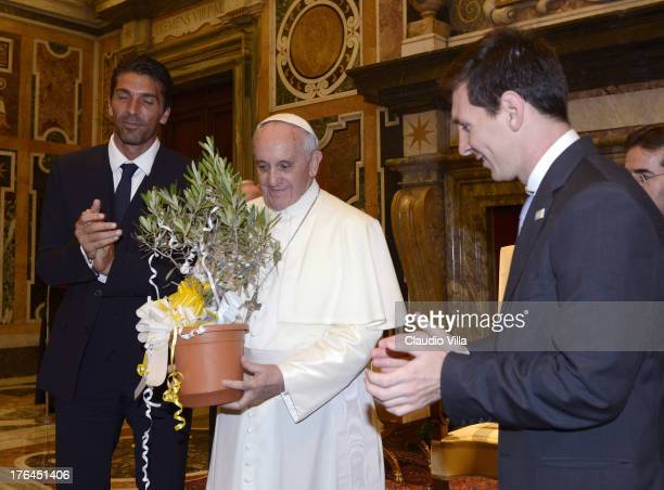 Pope Francis exchanges gifts with Gianluigi Buffon of Italy and Lionel Messi of Argentina during a private audience at The Vatican on August 13 2013...