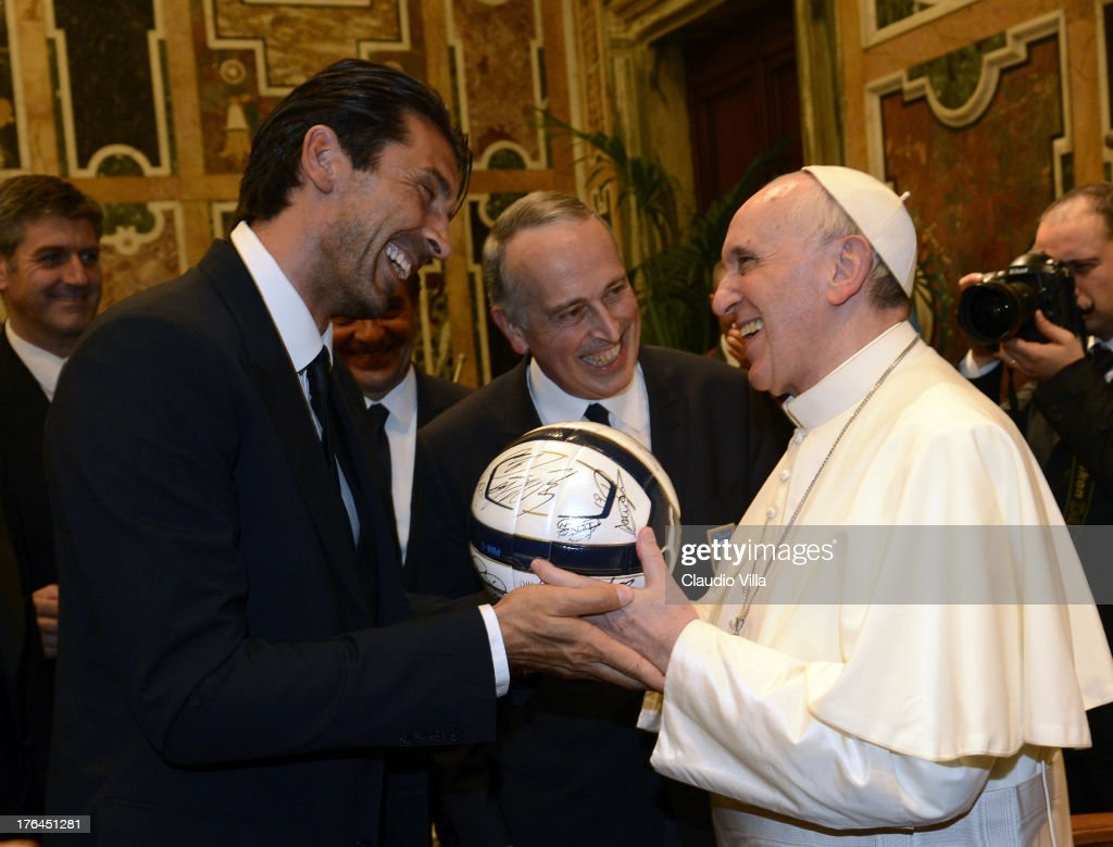 Pope Francis exchanges gifts with Gianluigi Buffon of Italy during an audience at The Vatican on August 13 2013 in Vatican City Vatican