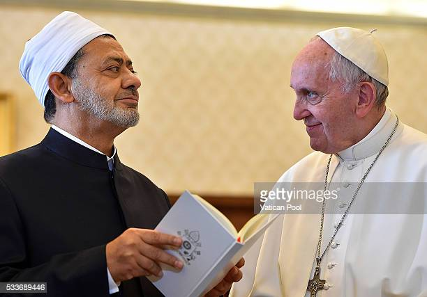 Pope Francis exchanges gifts with Grand Imam of AlAzhar Sheik Ahmed Muhammad AlTayyib during an audience at his private library in the Apostolic...