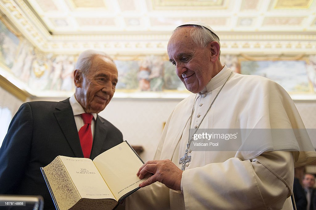 Pope Francis (R) exchanges gifts with Israeli president <a gi-track='captionPersonalityLinkClicked' href=/galleries/search?phrase=Shimon+Peres&family=editorial&specificpeople=201775 ng-click='$event.stopPropagation()'>Shimon Peres</a> (L) during an audience at his private library on April 30, 2013 in Vatican City, Vatican. The Pontiff and President <a gi-track='captionPersonalityLinkClicked' href=/galleries/search?phrase=Shimon+Peres&family=editorial&specificpeople=201775 ng-click='$event.stopPropagation()'>Shimon Peres</a> debated on a variety of issues concerning the Middle East during their meeting.