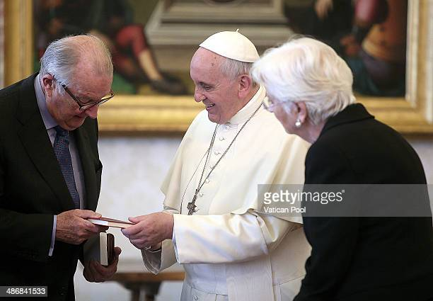 Pope Francis exchanges gifts with King Albert II and Queen Paola of Belgium at his private library in the Apostolic Palace on April 26 2014 in...