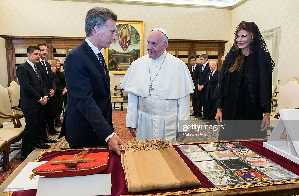 Pope Francis exchanges gifts with new President of Argentina Mauricio Macri and his wife Juliana Awada during an audience at the Apostolic Palace on...