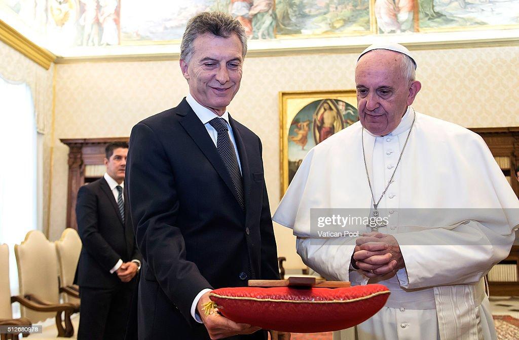 Pope Francis exchanges gifts with new President of Argentina Mauricio Macri during an audience at the Apostolic Palace on February 27 2016 in Vatican...