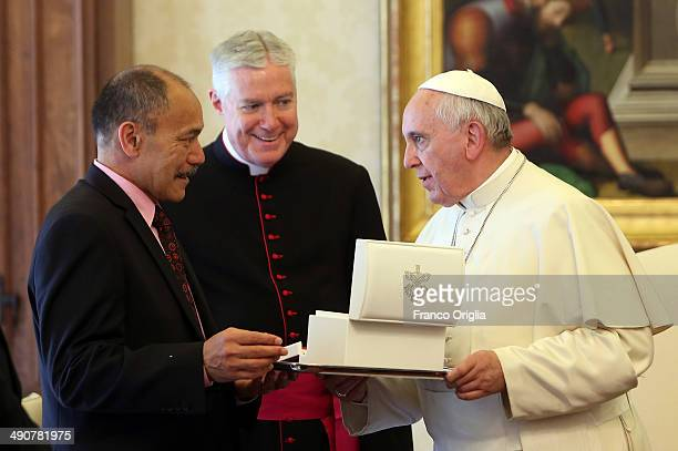 Pope Francis exchanges gifts with New Zealand's GovernorGeneral Jerry Mateparae during a private audience at the Apostolic Palace on May 15 2014 in...