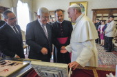 Pope Francis exchanges gifts with Palestinian President Mahmud Abbas also known as Abu Mazen during an audience on October 17 2013 in Vatican City...