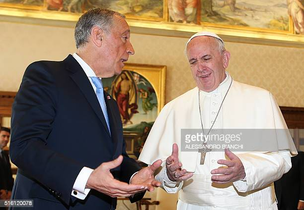 Pope Francis exchanges gifts with Portuguese President Marcelo Rebelo de Sousa during a private audience at the Vatican on March 17 2016 AFP PHOTO...