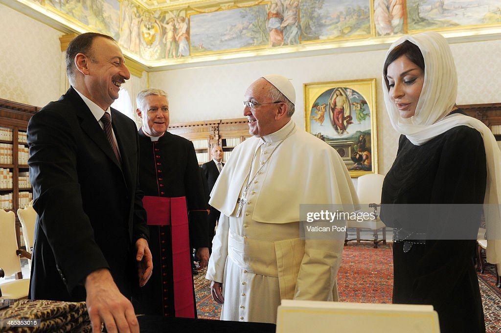 <a gi-track='captionPersonalityLinkClicked' href=/galleries/search?phrase=Pope+Francis&family=editorial&specificpeople=2499404 ng-click='$event.stopPropagation()'>Pope Francis</a> exchanges gifts with President of Azerbaijan <a gi-track='captionPersonalityLinkClicked' href=/galleries/search?phrase=Ilham+Aliyev&family=editorial&specificpeople=565601 ng-click='$event.stopPropagation()'>Ilham Aliyev</a> and his wife <a gi-track='captionPersonalityLinkClicked' href=/galleries/search?phrase=Mehriban+Aliyeva&family=editorial&specificpeople=576468 ng-click='$event.stopPropagation()'>Mehriban Aliyeva</a> at his private library in the Apostolic Palace on March 6, 2015 in Vatican City, Vatican. The importance of inter-religious dialogue and of negotiation in conflict resolution were among the key topics discussed.