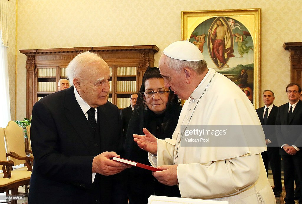 Pope Francis exchanges gifts with President of Greece <a gi-track='captionPersonalityLinkClicked' href=/galleries/search?phrase=Karolos+Papoulias&family=editorial&specificpeople=743016 ng-click='$event.stopPropagation()'>Karolos Papoulias</a> at his private library in the Apostolic Palace on March 28, 2014 in Vatican City, Vatican. The cordial discussions focused on issues of common interest, such as the legal status of religious communities, the role of religion in society, and ecumenical collaboration.