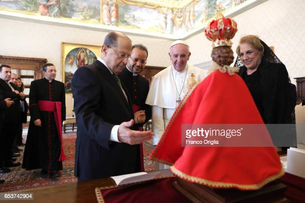 Pope Francis exchanges gifts with President of Lebanon Michel Aoun and his wife Nadia during an audience at the Apostrolic Palace on March 16 2017 in...