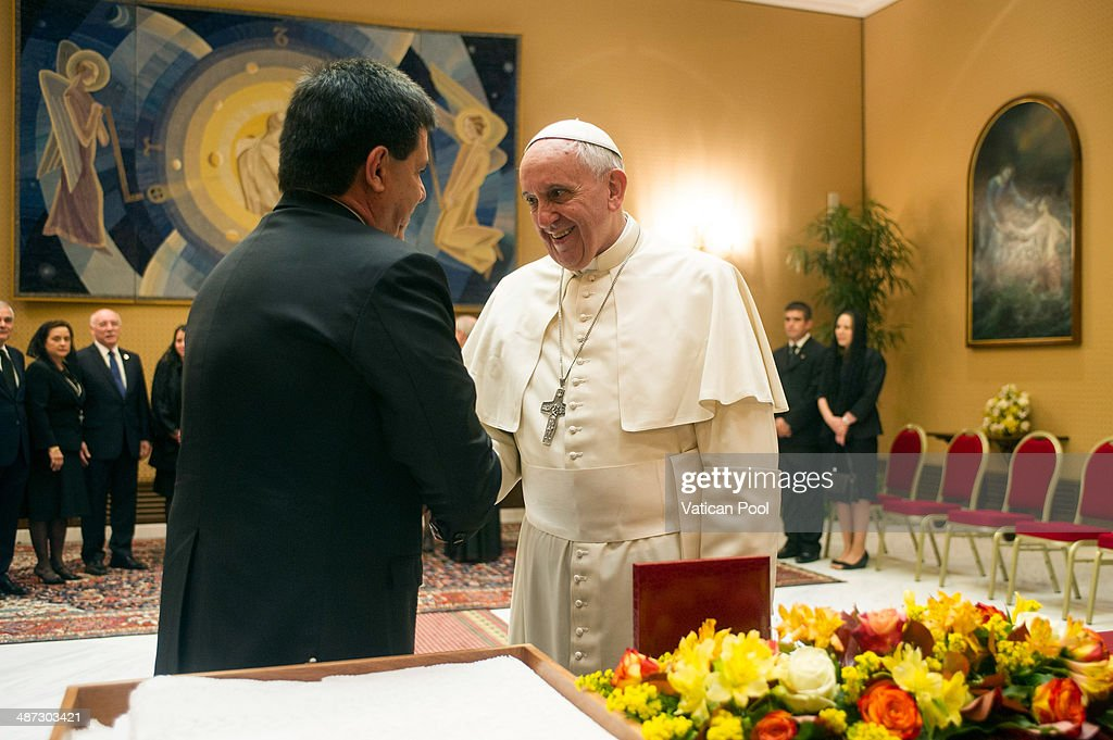 Pope Francis exchanges gifts with President of Paraguay Horacio Manuel Cartes Jara during an audience at the Paul VI Hall on April 29 2014 in Vatican...