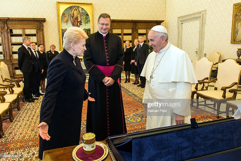Pope Francis exchanges gifts with president of the Republic of Lithuania Ms. <a gi-track='captionPersonalityLinkClicked' href=/galleries/search?phrase=Dalia+Grybauskaite&family=editorial&specificpeople=654850 ng-click='$event.stopPropagation()'>Dalia Grybauskaite</a> during a private audience at the Apostolic Palace on October 29, 2015 in Vatican City, Vatican. During the cordial discussions attention turned to a number of themes of common interest, such as European integration, the need for greater solidarity between nations to face various current challenges, the reception of migrants in Europe, peace and security at regional and international level and the conflict in Ukraine.