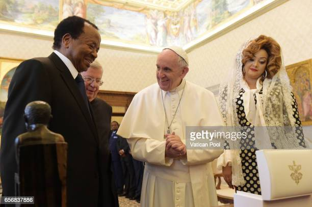Pope Francis exchanges gifts with President of the Republic of Cameroon Paul Biya and his wife Chantal Biya in a private audience at the Apostolic...