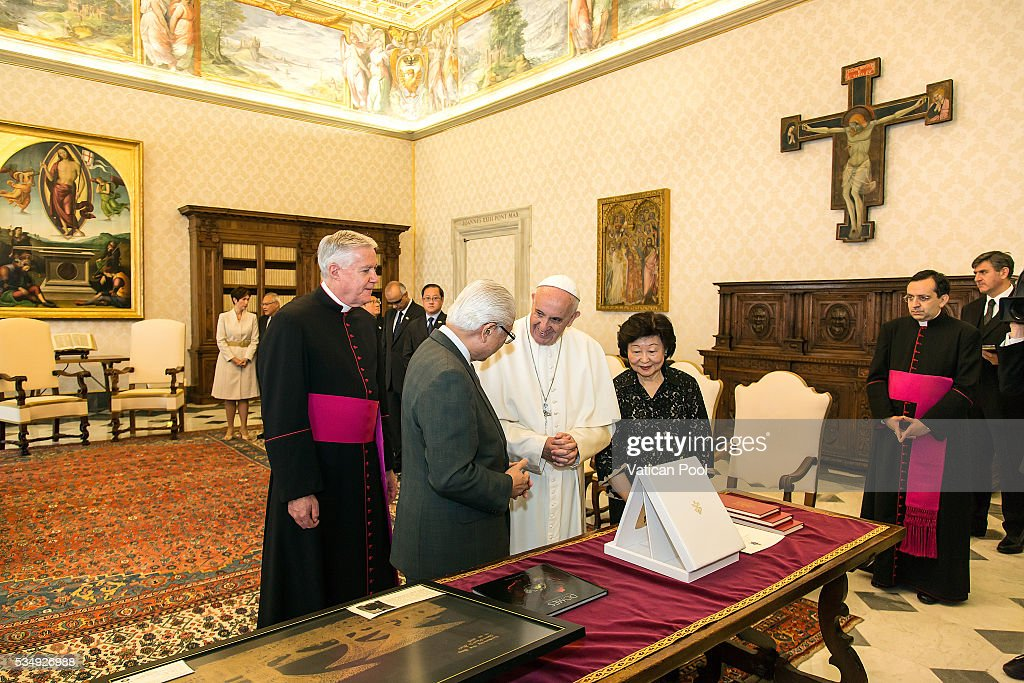 Pope Francis exchanges gifts with President of the Republic of Singapore <a gi-track='captionPersonalityLinkClicked' href=/galleries/search?phrase=Tony+Tan+Keng+Yam&family=editorial&specificpeople=6629941 ng-click='$event.stopPropagation()'>Tony Tan Keng Yam</a> during an audience at the Apostolic Palace on May 28, 2016 in Vatican City, Vatican. Two leaders spoke about certain international issues and the regional political situation, with particular reference to the importance of interreligious and intercultural dialogue for the promotion of human rights, stability, justice and peace in Southeast Asia.