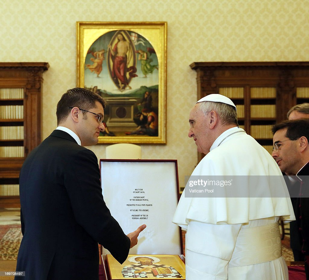 <a gi-track='captionPersonalityLinkClicked' href=/galleries/search?phrase=Pope+Francis&family=editorial&specificpeople=2499404 ng-click='$event.stopPropagation()'>Pope Francis</a> exchanges gifts with President of the United Nations General Assembly <a gi-track='captionPersonalityLinkClicked' href=/galleries/search?phrase=Vuk+Jeremic&family=editorial&specificpeople=4292588 ng-click='$event.stopPropagation()'>Vuk Jeremic</a> during an audience at his private library May 31, 2013 in Vatican City, Vatican. Human trafficking and the continued tension in the Middle East were the focus of <a gi-track='captionPersonalityLinkClicked' href=/galleries/search?phrase=Pope+Francis&family=editorial&specificpeople=2499404 ng-click='$event.stopPropagation()'>Pope Francis</a>' concerns in discussions with the President of the United Nations General Assembly, Serbian native, <a gi-track='captionPersonalityLinkClicked' href=/galleries/search?phrase=Vuk+Jeremic&family=editorial&specificpeople=4292588 ng-click='$event.stopPropagation()'>Vuk Jeremic</a>.