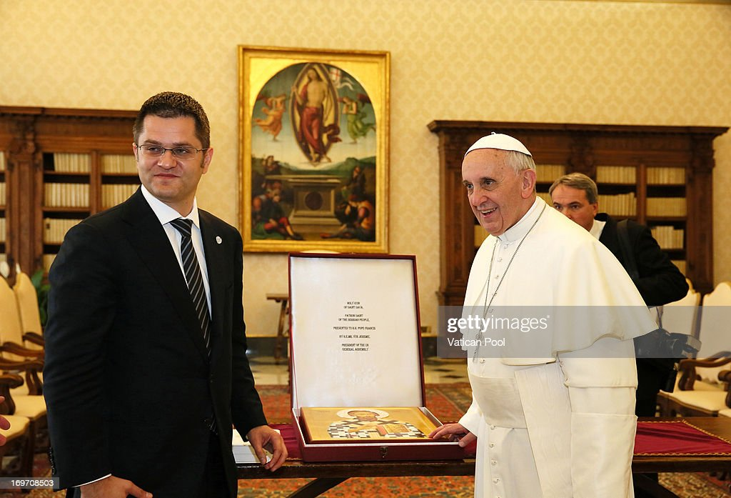 Pope Francis exchanges gifts with President of the United Nations General Assembly <a gi-track='captionPersonalityLinkClicked' href=/galleries/search?phrase=Vuk+Jeremic&family=editorial&specificpeople=4292588 ng-click='$event.stopPropagation()'>Vuk Jeremic</a> during an audience at his private library May 31, 2013 in Vatican City, Vatican. Human trafficking and the continued tension in the Middle East were the focus of Pope Francis' concerns in discussions with the President of the United Nations General Assembly, Serbian native, <a gi-track='captionPersonalityLinkClicked' href=/galleries/search?phrase=Vuk+Jeremic&family=editorial&specificpeople=4292588 ng-click='$event.stopPropagation()'>Vuk Jeremic</a>.