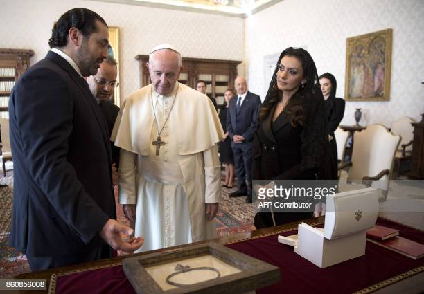 Pope Francis exchanges gifts with Prime Minister of Lebanon Saad Hariri and his wife Lara during a private audience at the Vatican on October 13 2017...