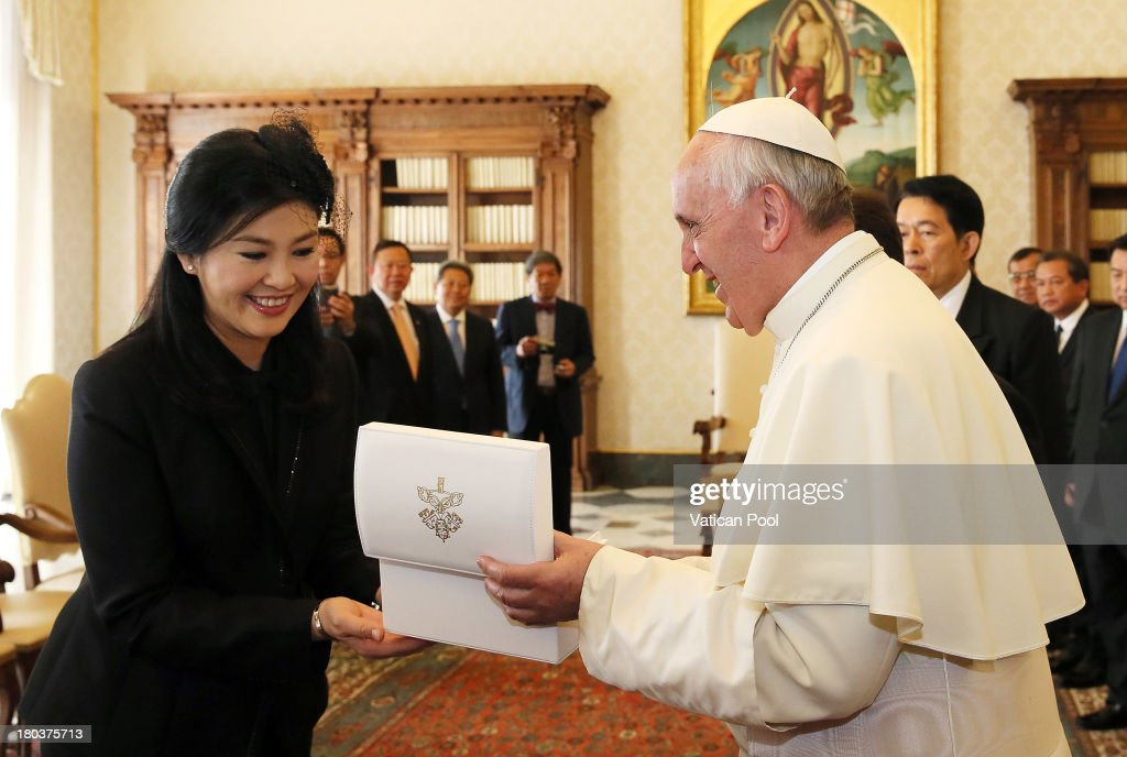 <a gi-track='captionPersonalityLinkClicked' href=/galleries/search?phrase=Pope+Francis&family=editorial&specificpeople=2499404 ng-click='$event.stopPropagation()'>Pope Francis</a> exchanges gifts with Thailand's Prime Minister <a gi-track='captionPersonalityLinkClicked' href=/galleries/search?phrase=Yingluck+Shinawatra&family=editorial&specificpeople=787330 ng-click='$event.stopPropagation()'>Yingluck Shinawatra</a> during an audience at his private library on September 12, 2013 in Vatican City, Vatican. During the meeting international issues and the political situation in the Asian continent have been reviewed, with particular reference to the importance of intercultural and interreligious dialogue for the promotion of human rights, peace and justice in the region.