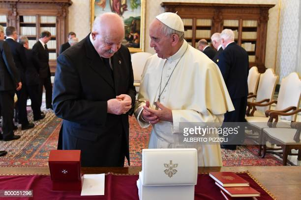 Pope Francis exchanges gifts with the Grand Master of the Sovereign Military Order of Malta Giacomo Dalla Torre del Tempio di Sanguinetto during a...