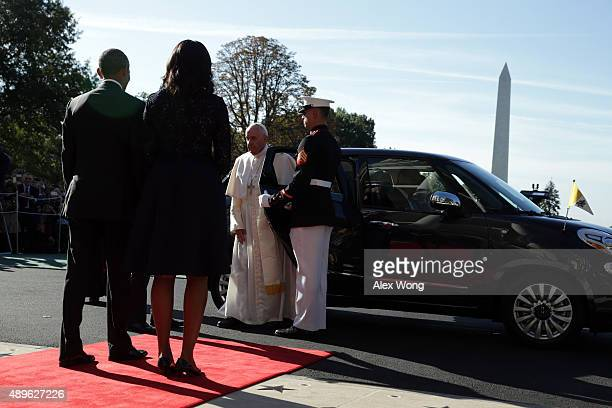 Pope Francis exits his car to greet the US President Barack Obama and first Lady Michelle Obama in an arrival ceremony at the White House on...