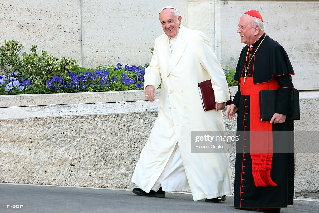 Pope Francis flanked by cardinal Franc Rode arrives at the Paul VI Hall for the Extraordinary Consistory on the themes of Family on February 21 2014...