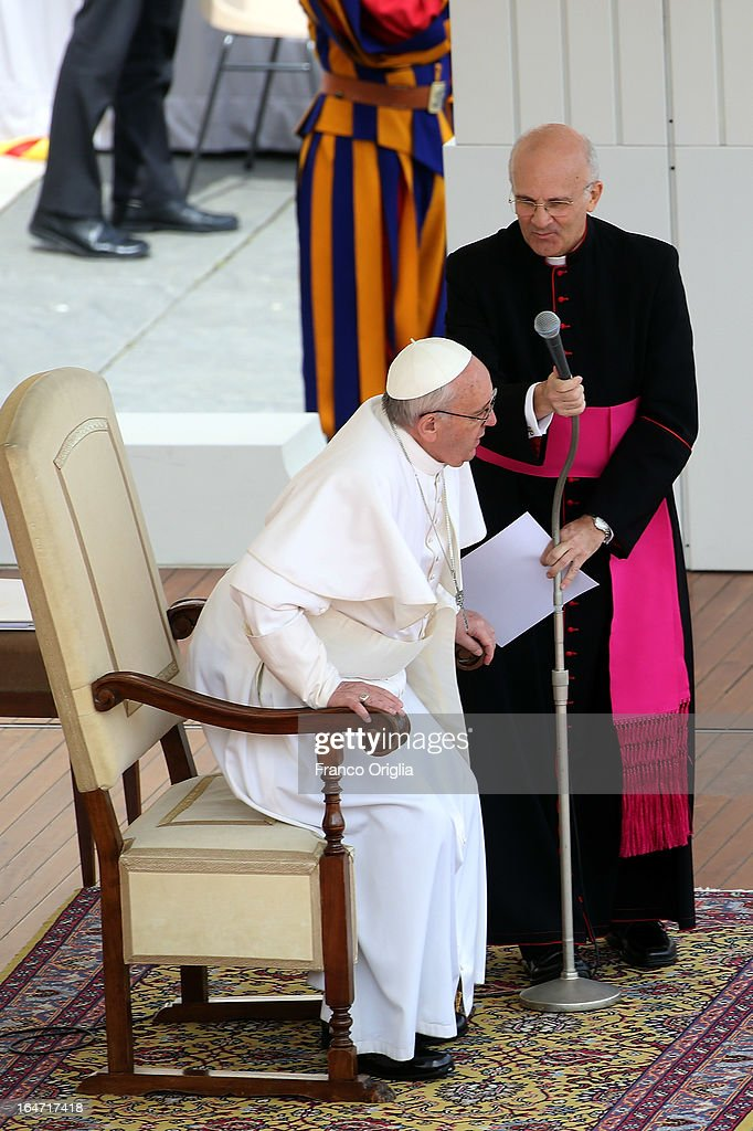 Pope Francis, flanked by his private secretary Alfred Xuereb (R), attends his first weekly general audience as pope in St Peter's Square on March 27, 2013 in Vatican City, Vatican.