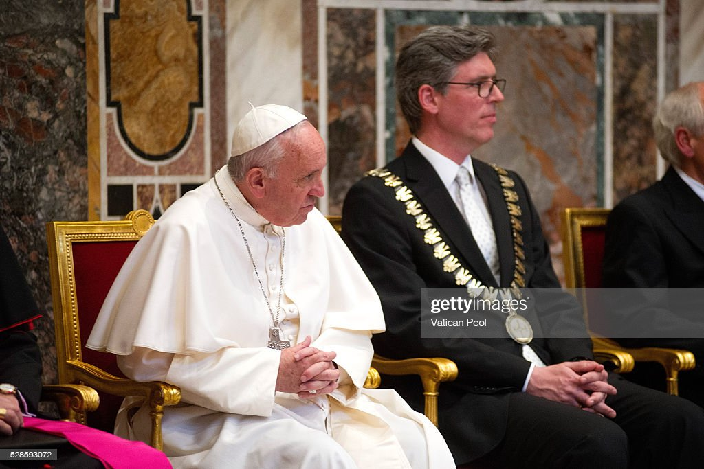 Pope Francis, flanked by Marcel Philipp (R), Mayor of Aachen, receives the Charlemagne Prize of Aachen at the Reggia Hall on May 6, 2016 in Vatican City, Vatican. The International Charlemagne Prize of Aachen is the oldest and best-known prize awarded for work done in the service of European unification.