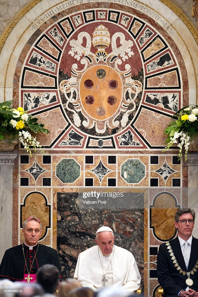 Pope Francis, flanked by Prefect of the Pontifical House Georg Ganswein (L) and Marcel Philipp (R), Mayor of Aachen, receives the Charlemagne Prize of Aachen at the Reggia Hall on May 6, 2016 in Vatican City, Vatican. The International Charlemagne Prize of Aachen is the oldest and best-known prize awarded for work done in the service of European unification.