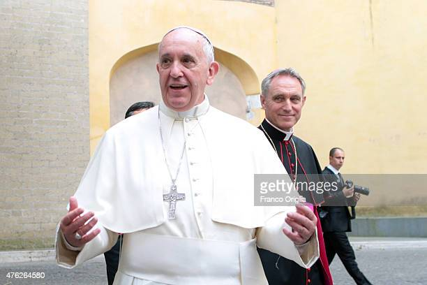 Pope Francis flanked by Prefect of the Pontifical House Georg Ganswein leaves the Paul VI Hall after an audience with President of Argentina Cristina...