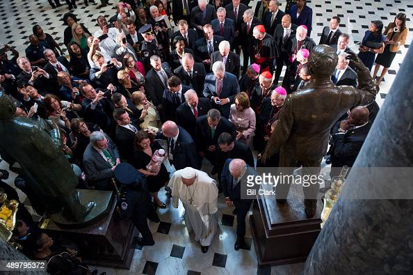 Pope Francis flanked by Speaker of the House John Boehner ROhio House Minority Leader Nancy Pelosi DCalif and Vice President Joe Biden exits Statuary...