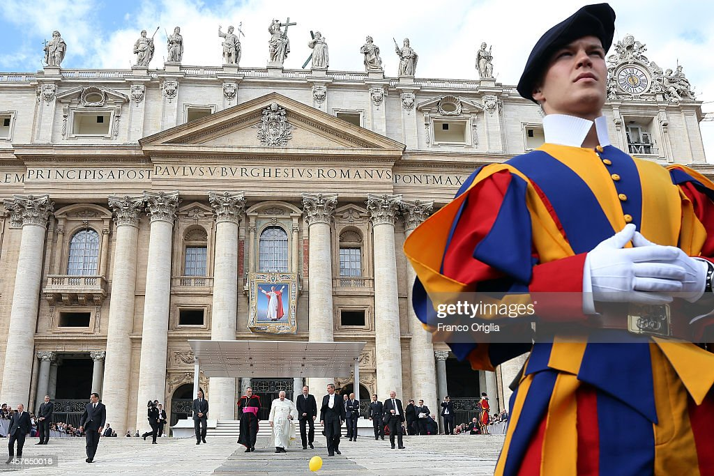 <a gi-track='captionPersonalityLinkClicked' href=/galleries/search?phrase=Pope+Francis&family=editorial&specificpeople=2499404 ng-click='$event.stopPropagation()'>Pope Francis</a>, flanked by the Prefect of the Pontifical House and former personal secretary of <a gi-track='captionPersonalityLinkClicked' href=/galleries/search?phrase=Pope+Benedict+XVI&family=editorial&specificpeople=201771 ng-click='$event.stopPropagation()'>Pope Benedict XVI</a>, Georg Ganswein (L), arrives for his weekly audience in St. Peter's Square on October 22, 2014 in Vatican City, Vatican. Speaking to the crowds gathered in St. Peter's Square for the weekly General Audience, <a gi-track='captionPersonalityLinkClicked' href=/galleries/search?phrase=Pope+Francis&family=editorial&specificpeople=2499404 ng-click='$event.stopPropagation()'>Pope Francis</a> said 'War does not begin on the battlefield: war, wars begin in the heart, with this misunderstanding, division, envy, with this fighting among each other'.