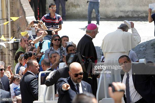 Pope Francis flanked by the president of CEI Msgr Nunzio Galantino waves to the faithful as he arrives at the Cassano's Seminary on June 21 2014 in...