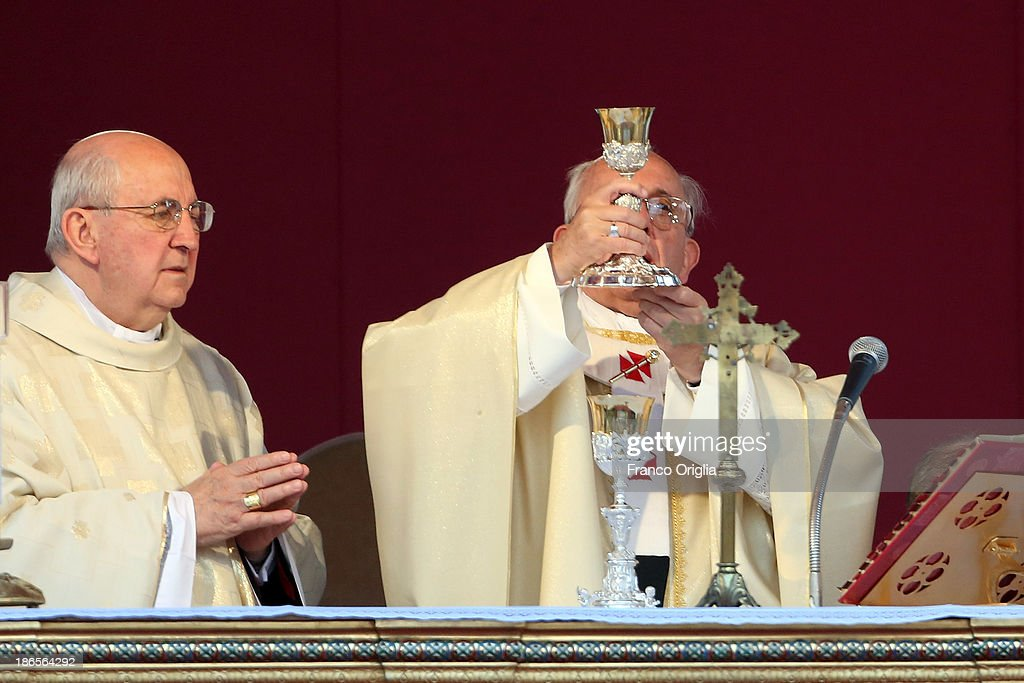 Pope Francis, flanked by Vicar General of Rome cardinal Agostino Vallini (L), celebrates solemnity of all Saints at the Monumental Cemetery of Verano on November 1, 2013 in Rome, Italy. The pontiff celebrated Mass on Friday marking the solemnity of All Saints and afterwards prayed for the migrants who died in the desert or drowned at sea. The Mass was celebrated at the entrance of Rome's Verano cemetery and took place exactly 20 years after the last papal visit there.