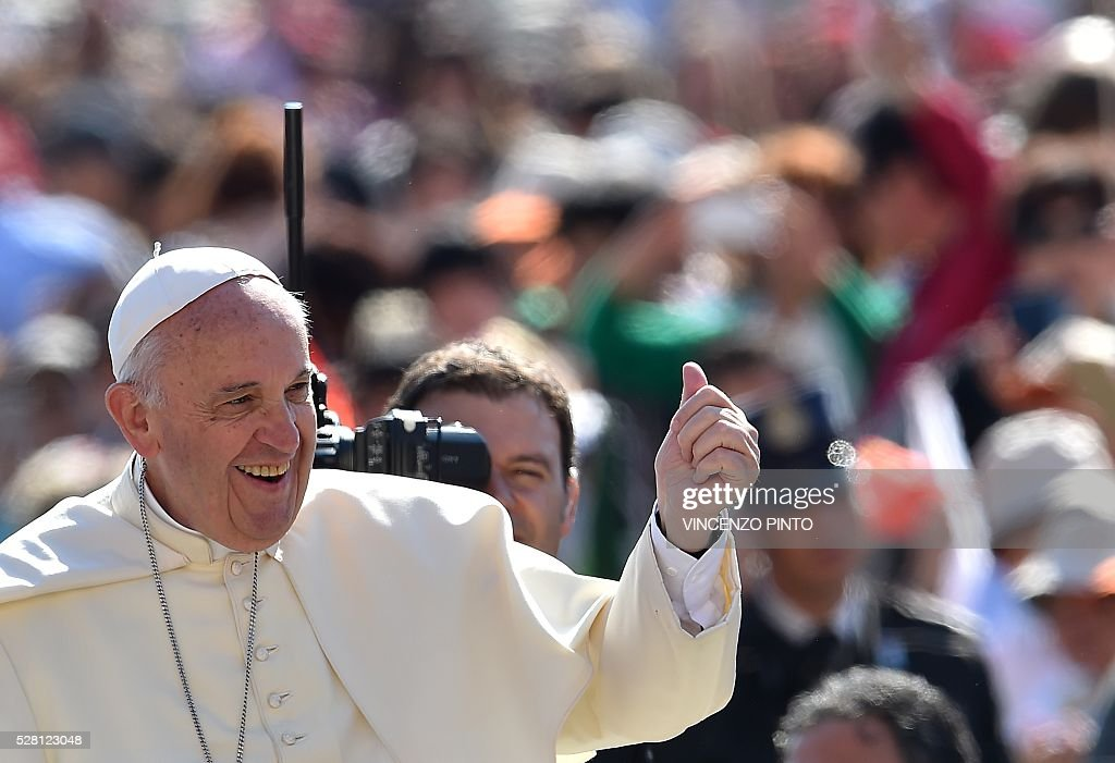 Pope Francis gestures at the end of his weekly general audience in Saint Peter's square at the Vatican on May 4, 2016. / AFP / VINCENZO