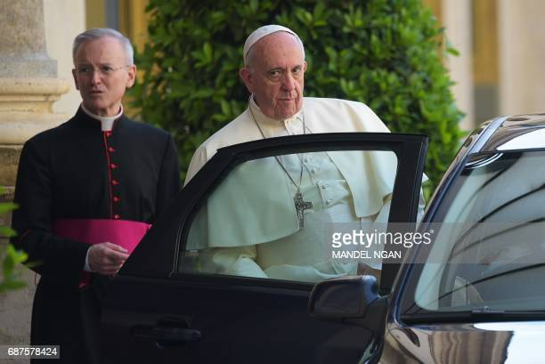 Pope Francis gets into a car in San Damaso courtyard at the Vatican after a meeting with US President Donald Trump on May 24 2017 in Vatican US...