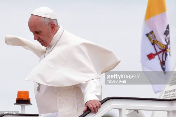 Pope Francis gets off his plane upon his arrival at the Monte Real Air Base central Portugal prior to visiting Fatima shrine on May 12 2017 Two of...