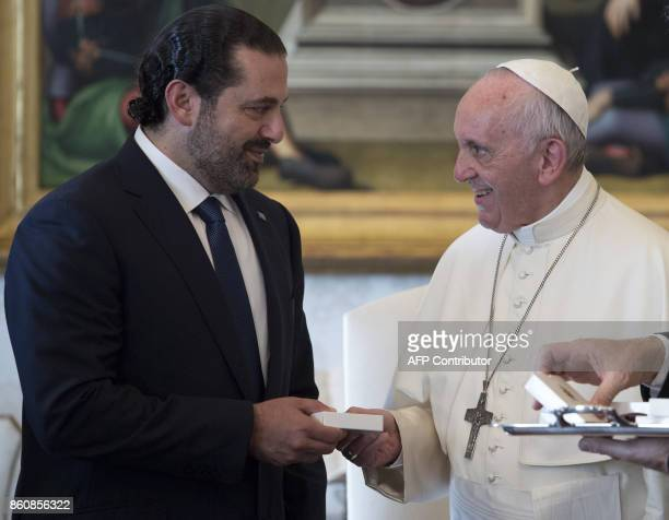Pope Francis gives a rosary to Prime Minister of Lebanon Saad Hariri during a private audience at the Vatican on October 13 2017 / AFP PHOTO / POOL /...