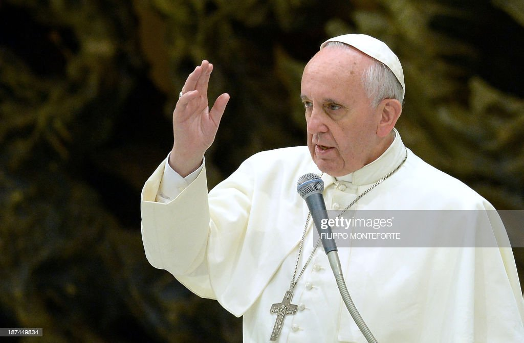 Pope Francis gives his blessing during his meeting with the Italian Union for the transportation of sick people to Lourdes and International Shrines (UNITALSI) on November 9, 2013 in the Paul VI hall at the Vatican.